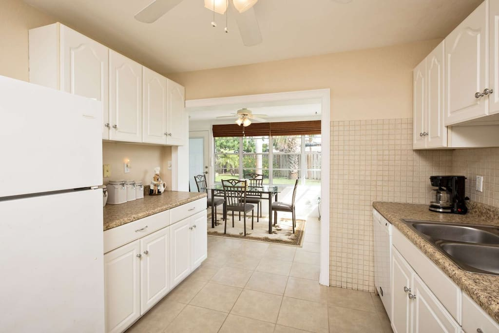 Spacious kitchens leads to sunny Florida room.