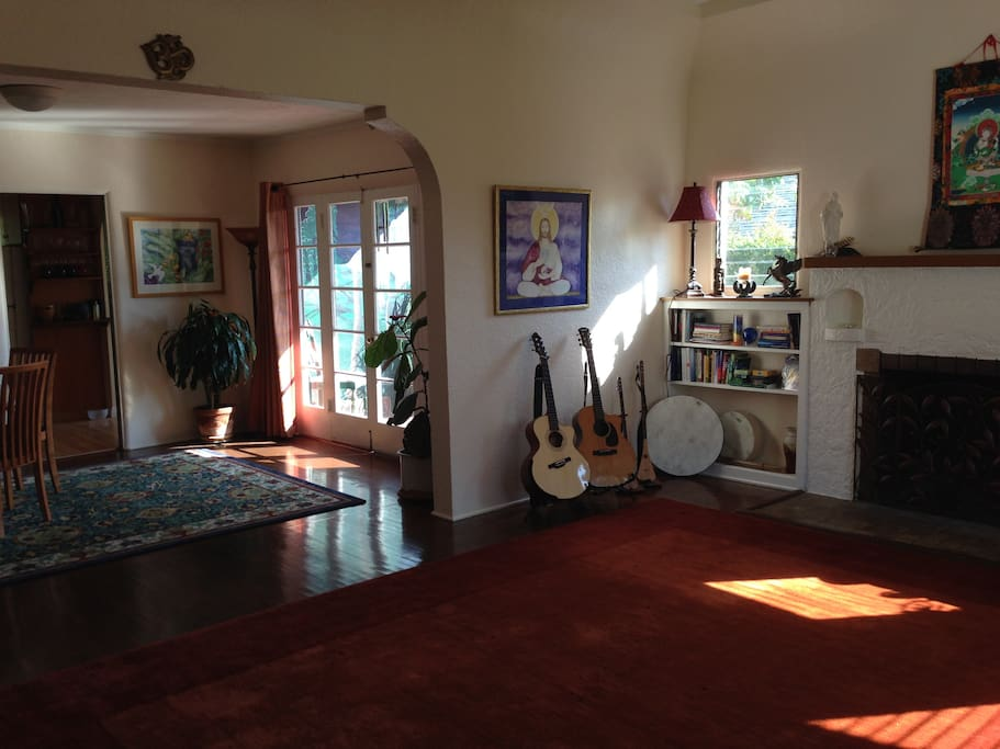 Living room into dining. French doors open to side patio with mural
