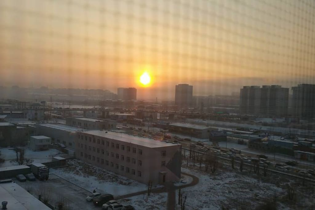 Sunrise over Ulaanbaatar from the east facing balcony. This balcony and the west facing balcony shows most of Ulaanbaatar