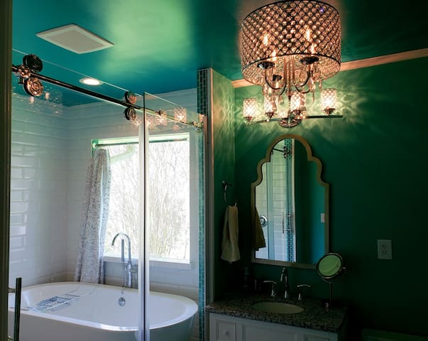 Chandelier in the bathroom? Why not? You deserve to treat yourself. A center mount drain makes it perfect for one...or two!