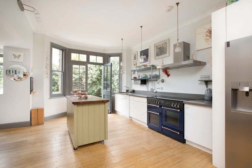 Large airy kitchen opens onto garden