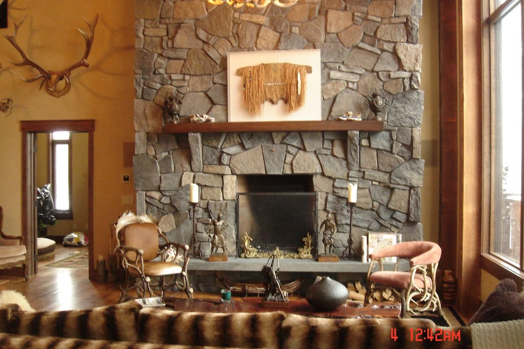 The Grande room with wood burning fireplace and magnificent mountain views
