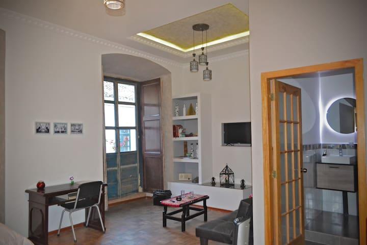 Your comfortable room with special lighting and furniture, you'll feel at home / Tu acogedora habitación con iluminación y mobiliario especial para que te sientas como en casa