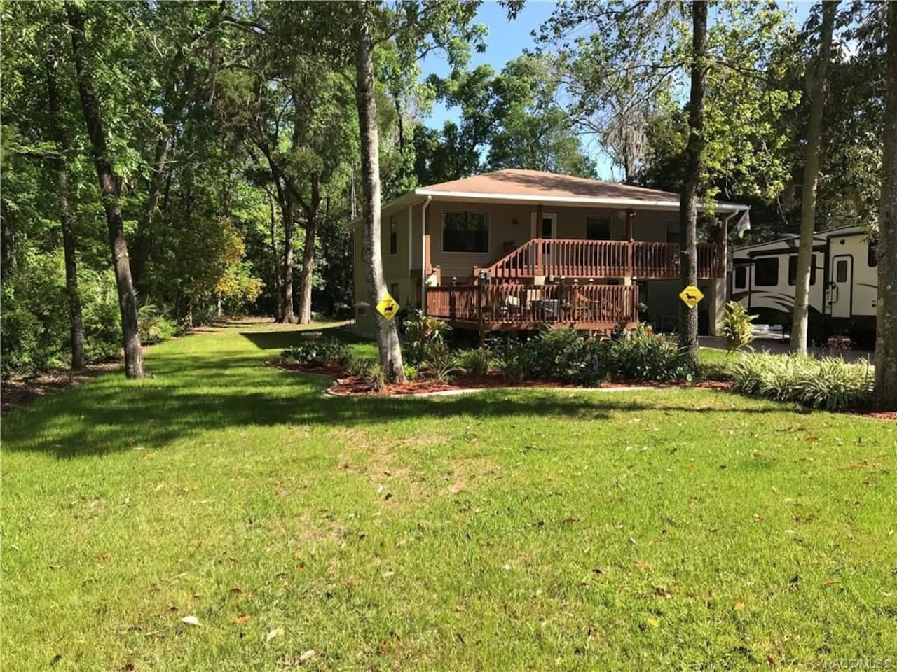 Street view! Quiet home on a secluded, wooded street.  Cozy ground floor apartment with a private entrance. Very close to Three Sister's Springs and manatee viewing!