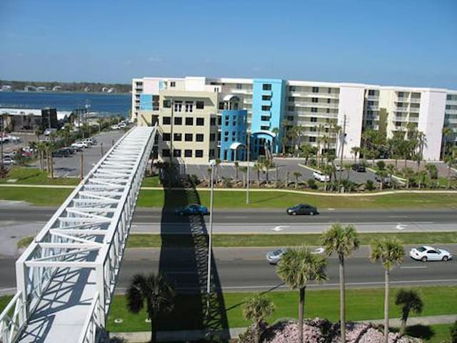 Pedestrian skybridge walking over Miracle Strip Parkway. Overlooking the bayside of Destin West.