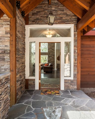 Entry to the Timberline Lodge surrounded by ledger stacked stone