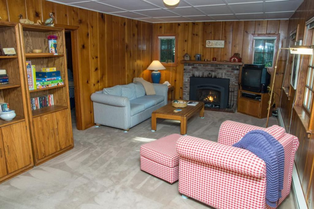 Living area with comfy sofas, fireplace, flat screen T.V., WI-FI, and cable.