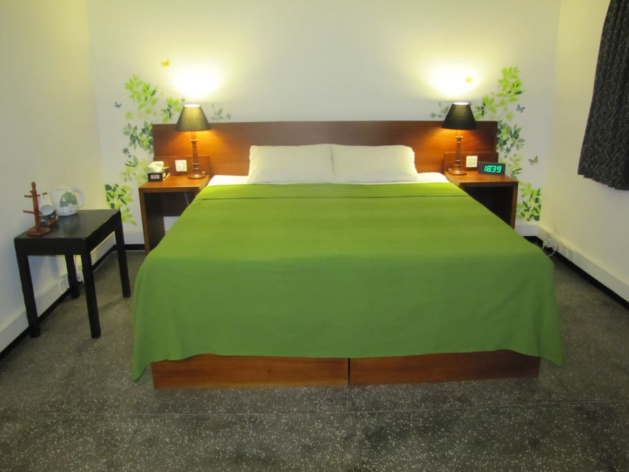 Double rooms (extra fee) include en-suit bathroom, reading light, cupboard and alarm clock