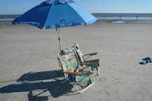 Enjoy our backpack beach chairs and umbrella