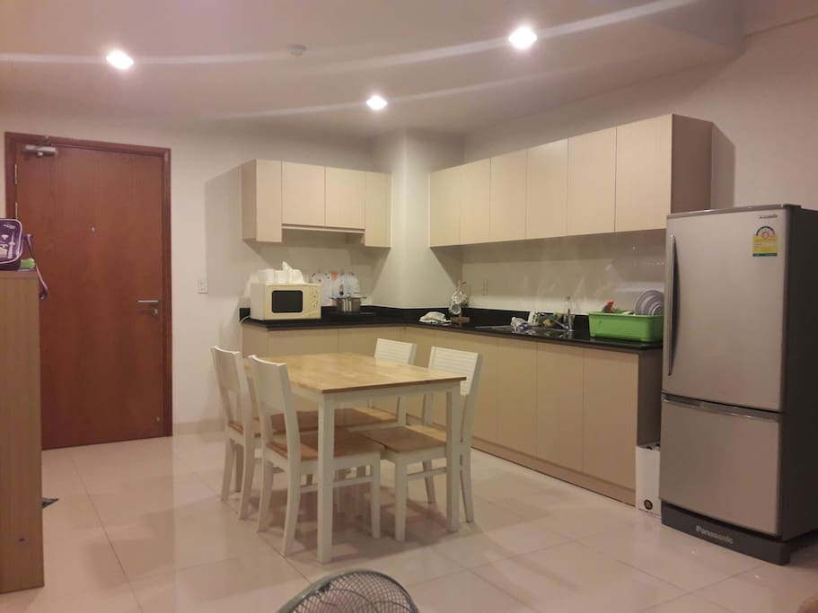 Kitchen with fridge,  microwave