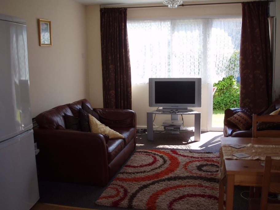 Comfortable living room area and Tv/DVD etc