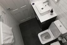 One of four identical bathrooms