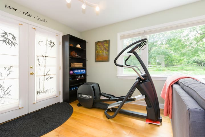 Elliptical trainer and weight area.  Yoga mat provided.