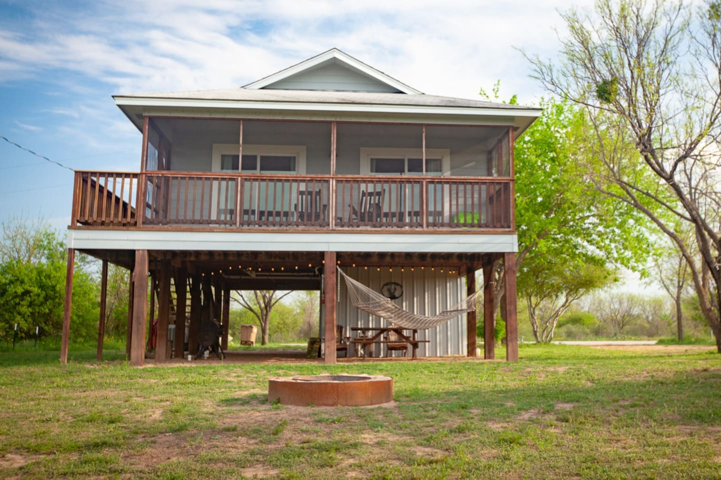 The Llano River House features comfort among wide open spaces in the Texas Hill Country. Elevated view pairs nicely with the screened in porch, hammock, fire pit and picnic table. Make this beach house build your home base for relaxing & exploring!