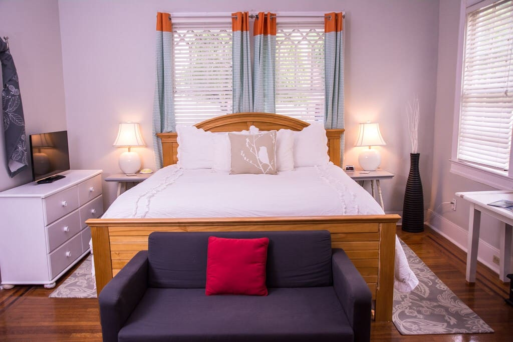 Very comfy queen bed in downstairs master bedroom with fireplace and tv