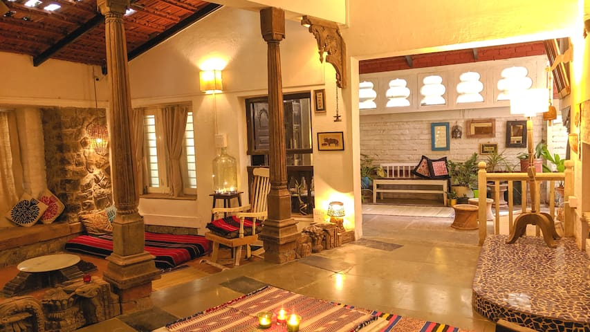 Common area on ground floor, made from recycled old wooden pieces (some more than 100years old) all are collected from different scrapyards over the period of time, mud tiles, glass roof and handwoven textiles. Enjoy the peace, colors and textures