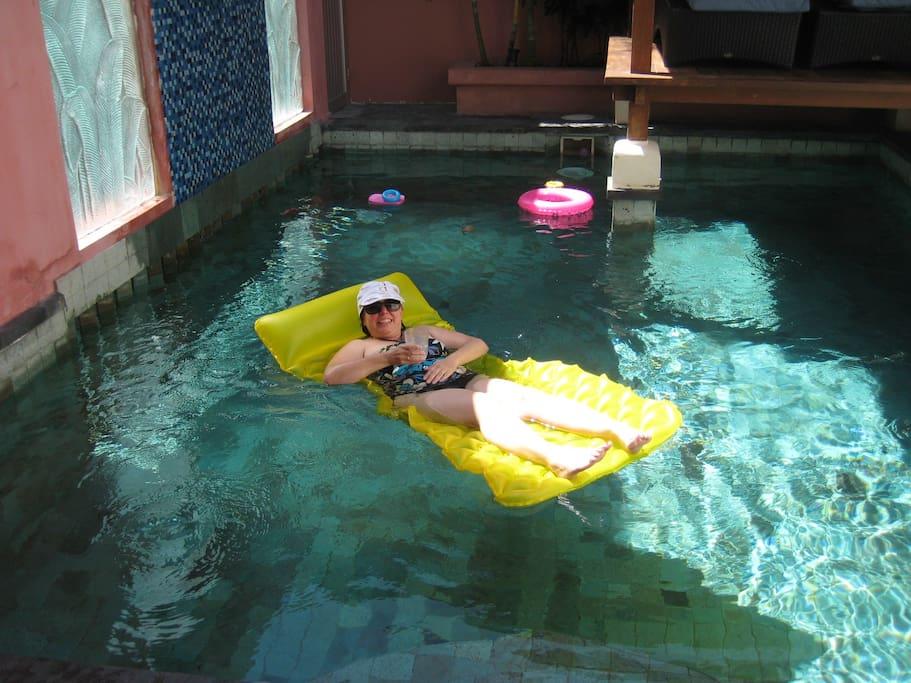 enjoying one of the pools