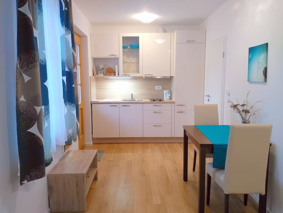 Fully equiped kitchen with fridge, stove, water, pens, dishes...