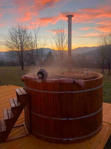 Hot tub on terrace and sunset