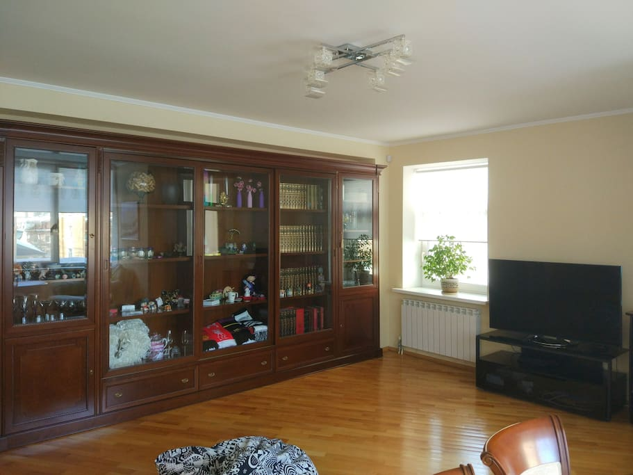 large living room with a big sofa-bed, table for 6, LD TV set, air conditioner