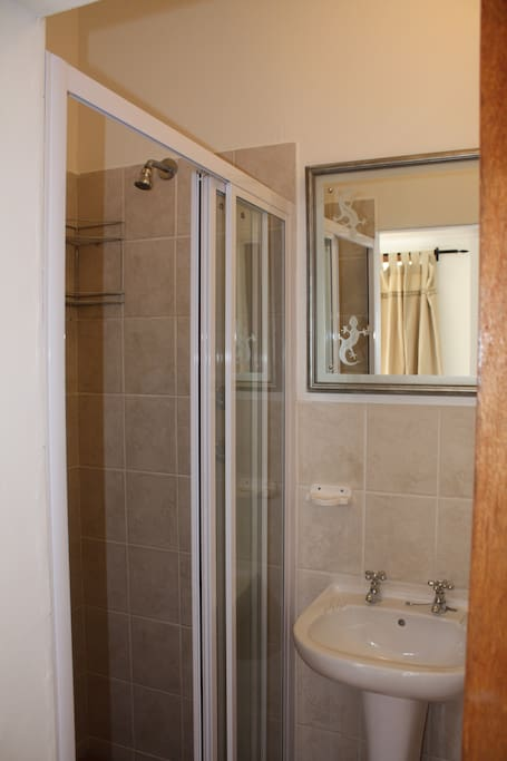 small bathroom with shower, basin and toilet