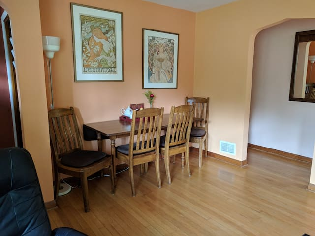 The dining nook is part of the living room. Pull out the table for seating for 6+. Chairs in front door closet.
