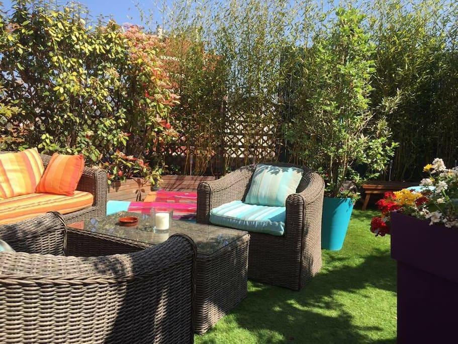 terrasse rooftop avec solarium, hamac, espace barbecue