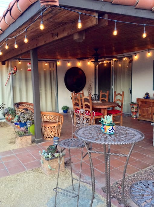 Party lights and misters create ambiance for covered patio