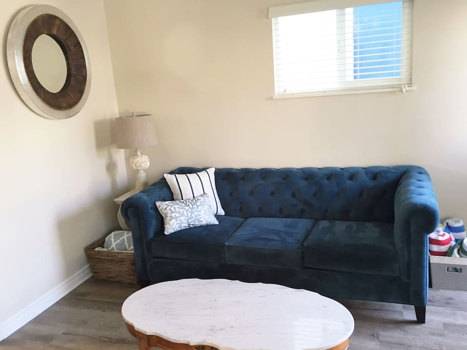 Relax on the comfortable sofa.  Great for watching TV, reading or needle point.