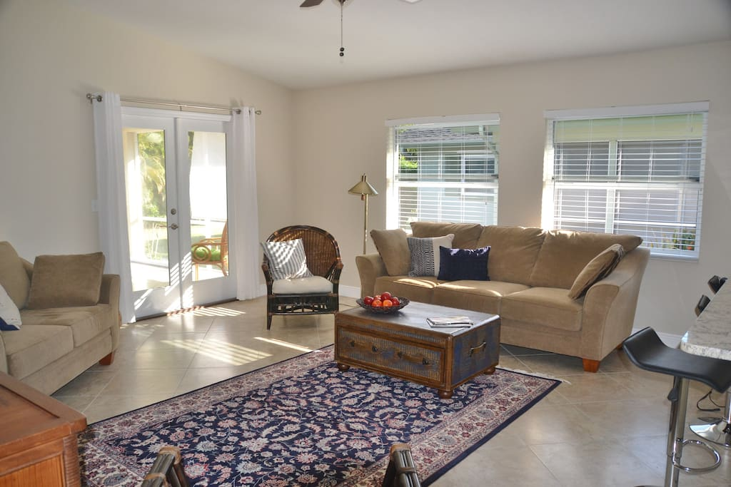 Open, airy, comfortable living area, opening to screened lanai.
