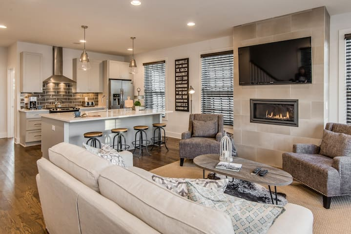 The open living, kitchen, and dining area is made for entertaining and socializing.