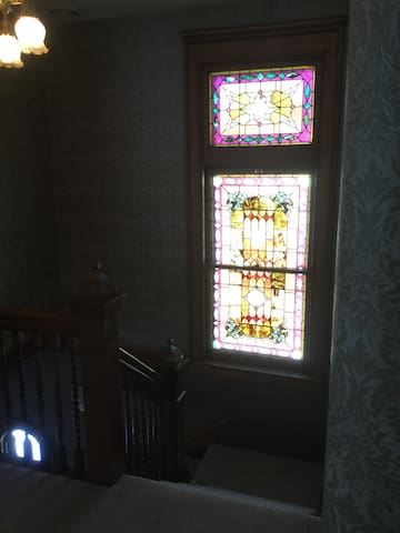 Front stairs with original stained glass
