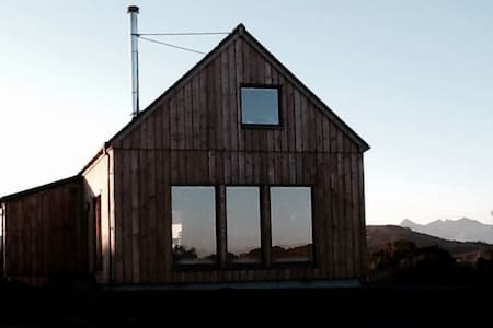 Skye nr Portree.   Luxury Scandi style eco house.