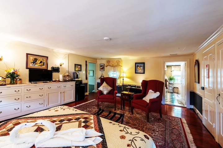 The Suite offers a bright and expansive Sitting Area to relax & enjoy snacks and your large screen cable HDTV, fast WIFI, Refrigerator, microwave and coffee/tea Service. And, yes, all amenities are included in your price.