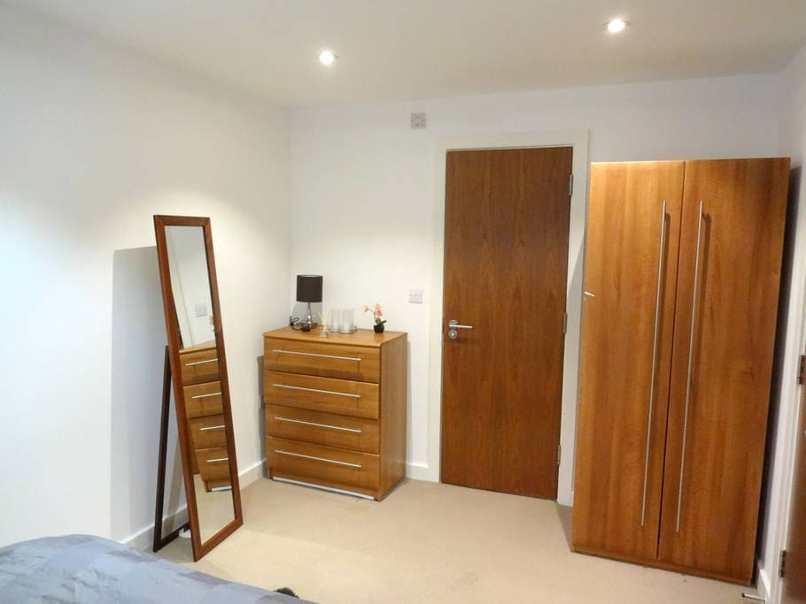 Your bedroom also has wooden cupboard for your clothes and matching coloured cabinet, and a matching full-length mirror. The door leads to your private bathroom that is ensuite (inside your bedroom)