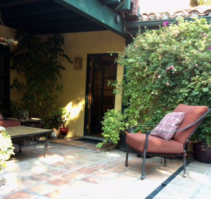 Your own private entrance with patio seating area