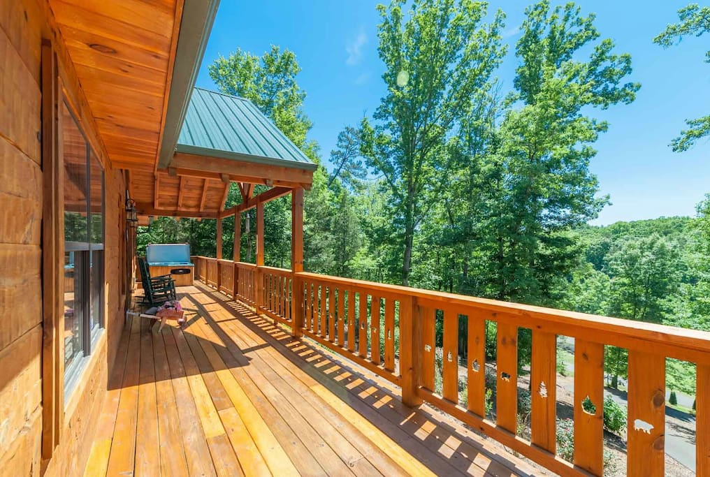 Relax on large front porch overlooking nature's finest