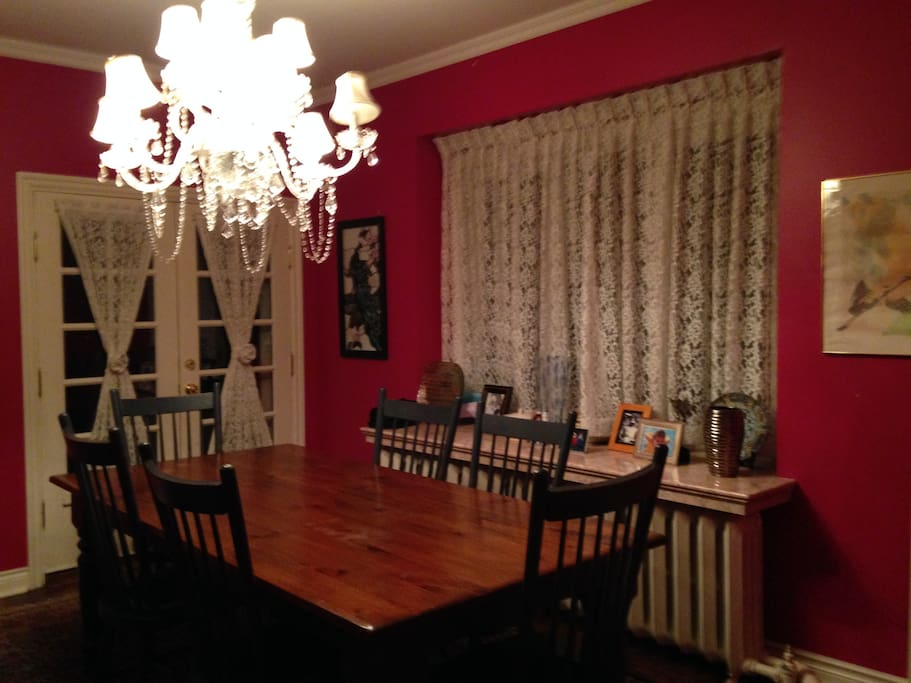 Chandeliered formal dining area with rustic Mennonite dining table