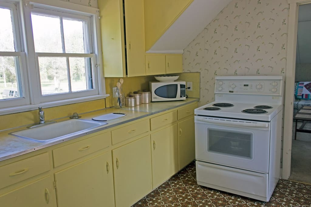 The kitchen has a stove/oven, counter top microwave, coffee maker, coffee grinder, electric kettle, & toaster.