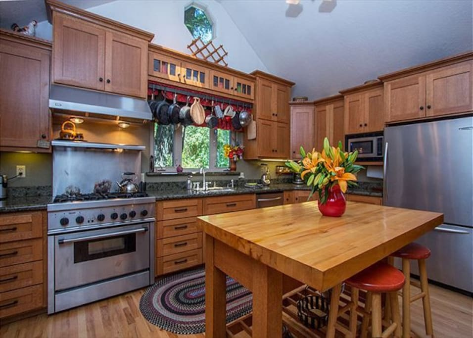 The kitchen -A cooks dream w/large island, great stove & huge refridgerator.