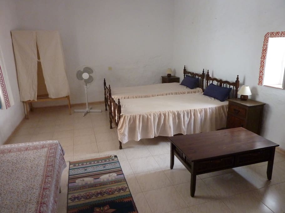 back bedroom with 3 single beds