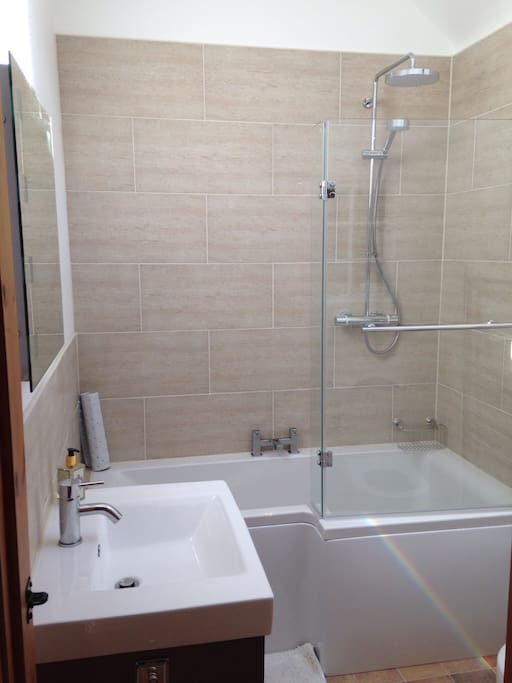 Bath with Mira shower, large 2 drawer basin unit, WC.