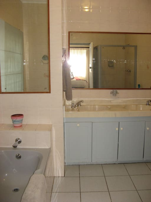 Full en-suite bathroom with bath and separate shower