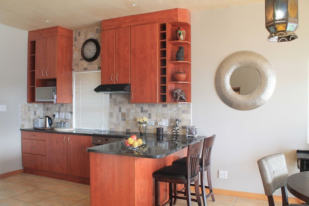 Modern, fully-equipped kitchen with stove, oven and dishwasher.