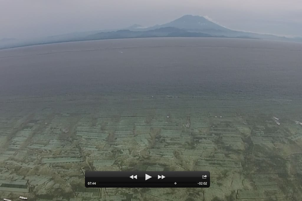 Aerial view of seaweed farming and Mt. Agung, from Tranquility Lembongan