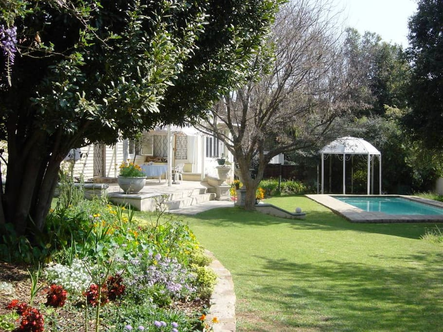 Landscaped garden with pool and barbeque area