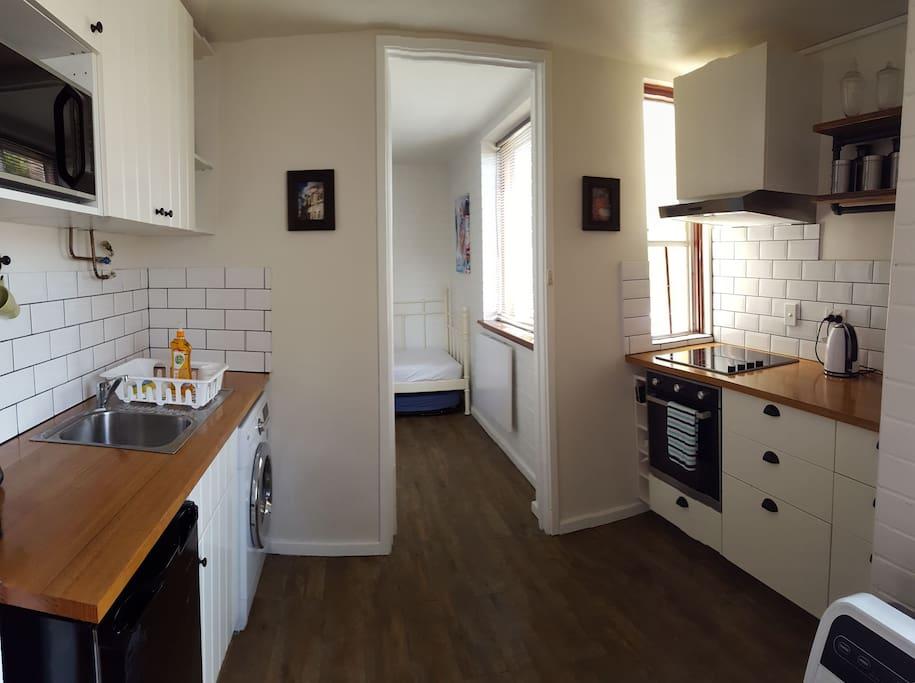 full kitchen including washing machine/ dryer