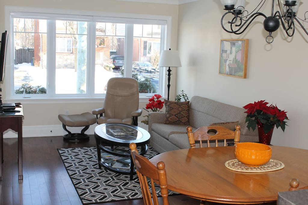 The open concept living room/dining room/kitchen gives you well lit spaces to visit, eat, cook and watch TV.