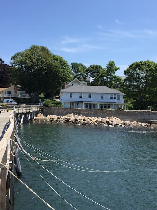 The house viewed from the Magnolia pier. Sunbath, swim or fish off the enormous attached dock!