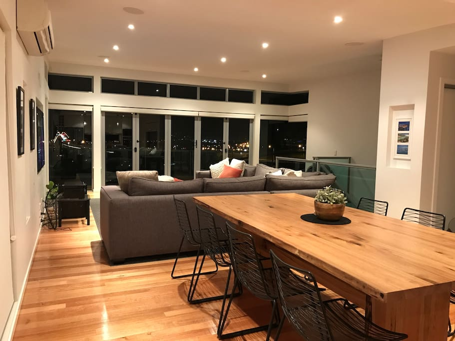 open plan living and dining areas with amazing night views of the Tasman Bridge and City
